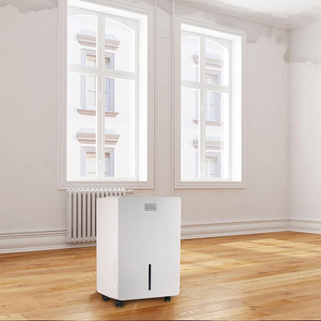Dehumidifier With Pump In A Room