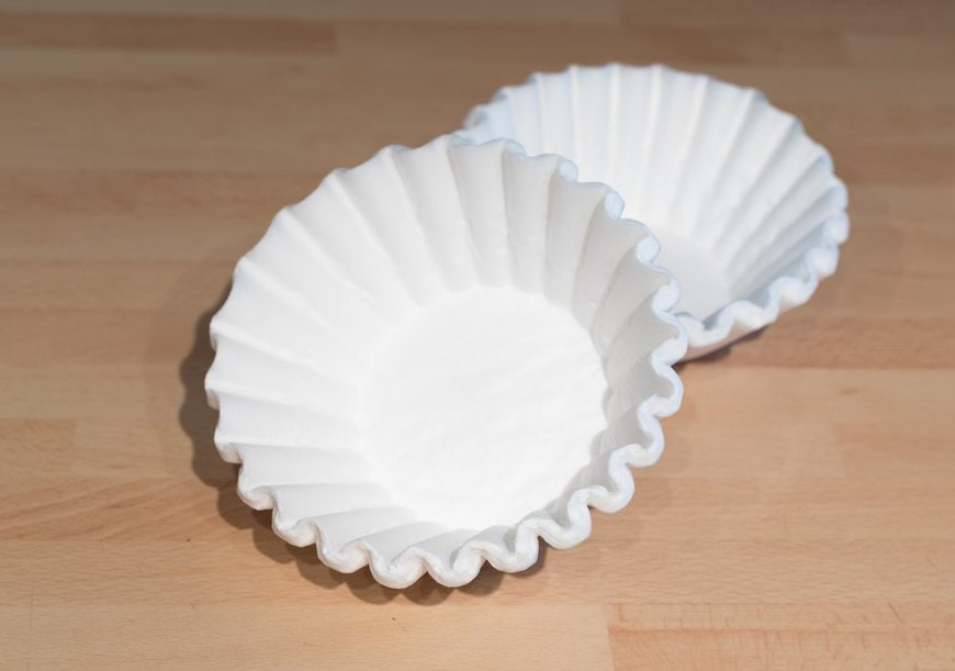 White coffee filters on a wooden table