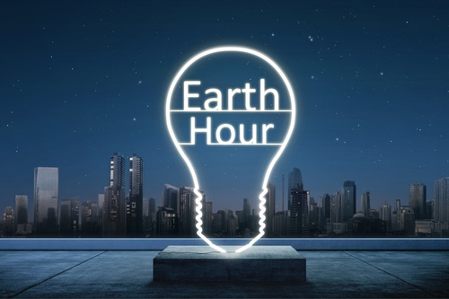 Earth hour text inside of lights bulb
