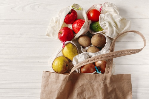 zero waste food shopping. eco natural bags with fruits and veget