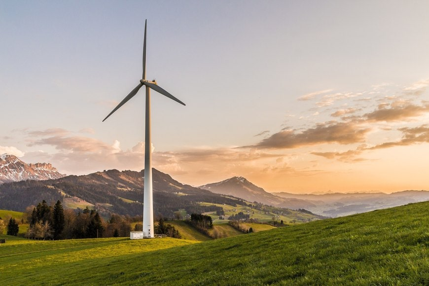 Wind turbine on the freen mountain during sunset