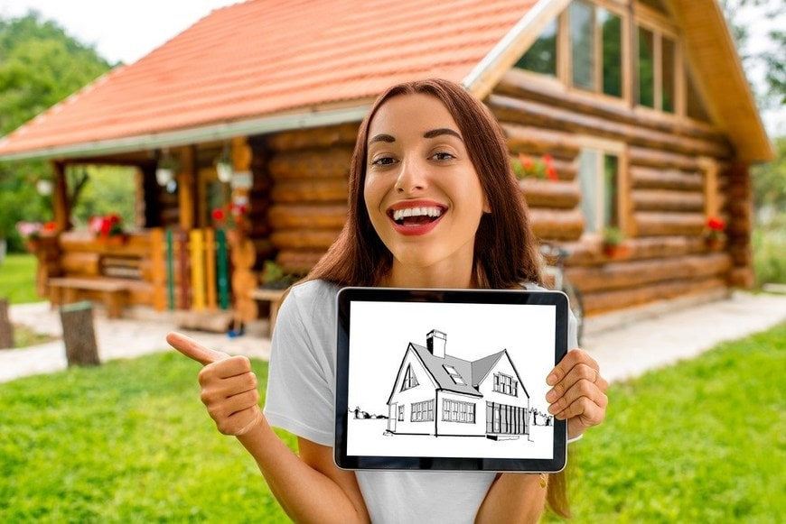 Woman showing digital tablet with house drawing