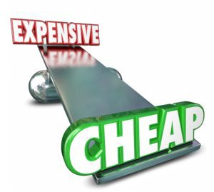 Cheap Vs Expensive 3d Words on a scale or balance to illustrate or compare prices or costs to find the best deal, bargain or value