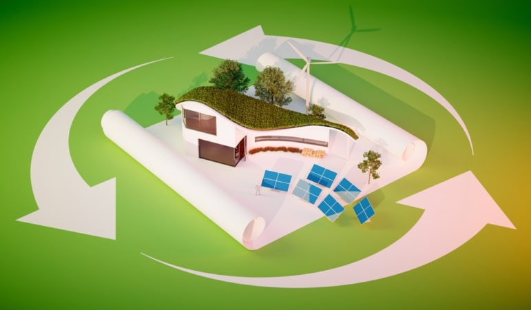 Concept of sustainable living - modern style organic shape building with grass roof and independent energy source