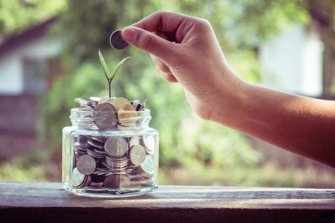 hand putting money coins
