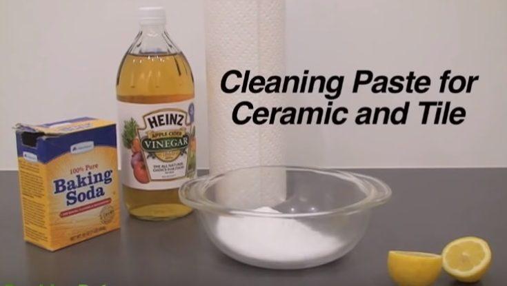 Baking soda, vinegar, clear mixing bowl, lemon