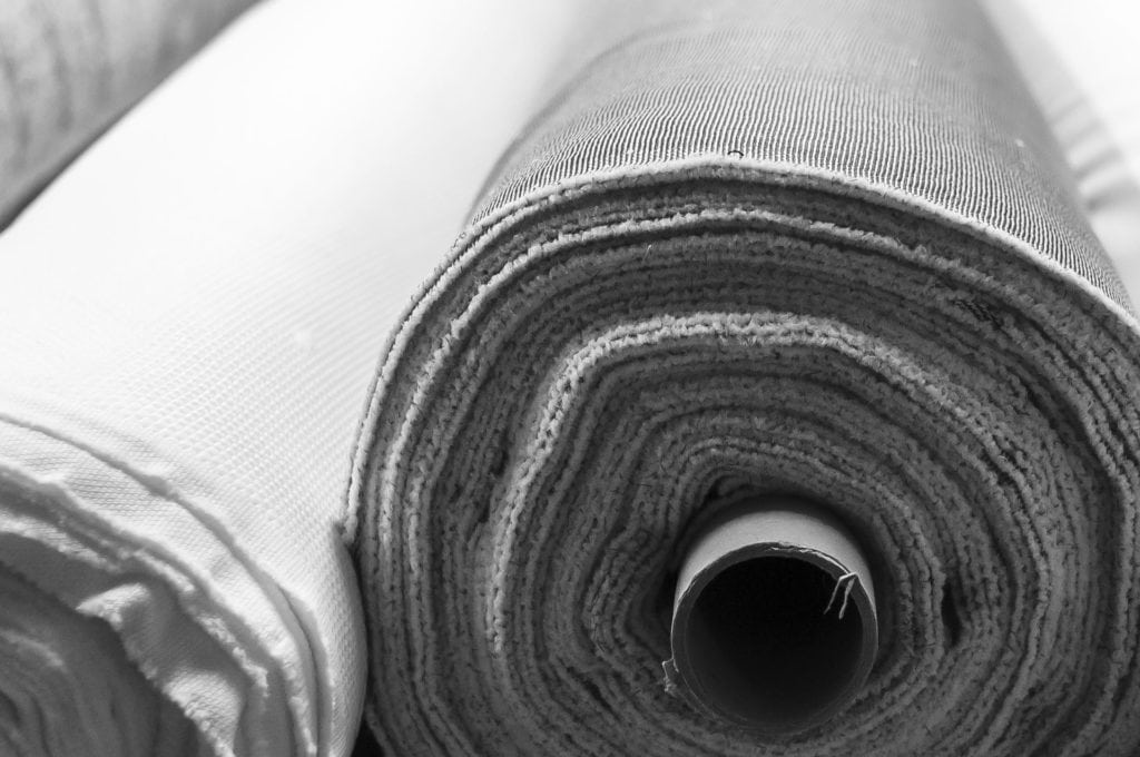 Fabric rolls in gray and white color