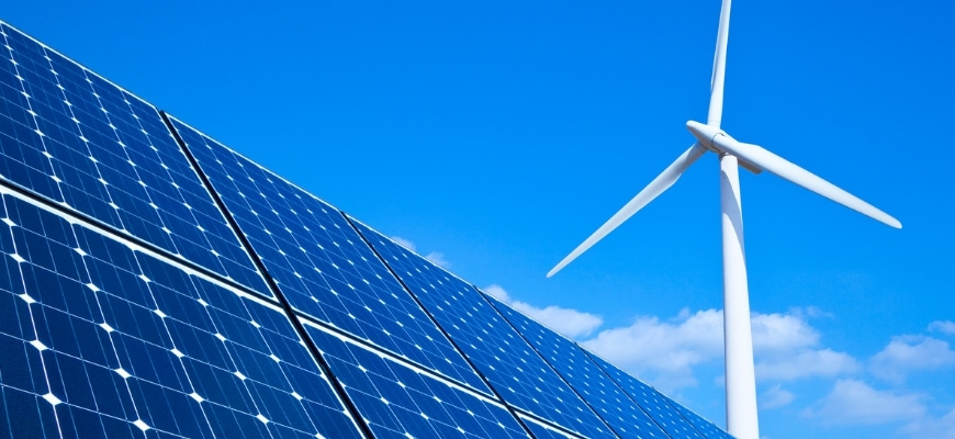 Wind turbine with solar panel in blue sky background