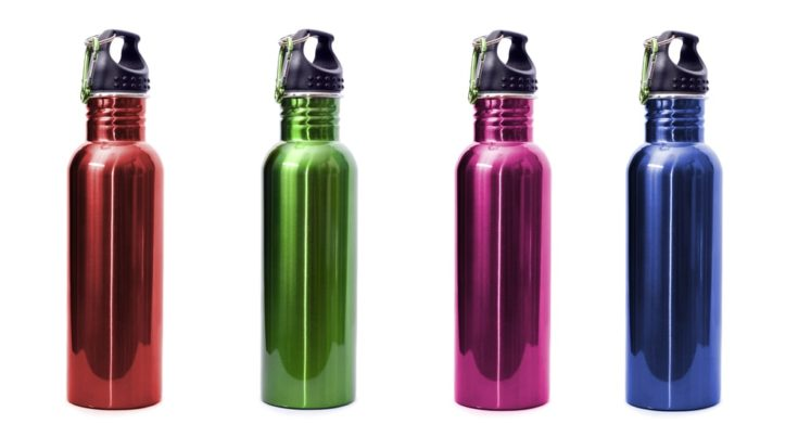 A set of four safe, reusable stainless steel water bottles isolated on white background in red, green, pink, and blue.