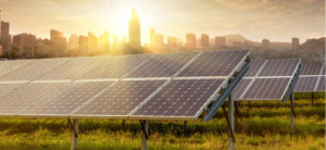 The Downside to Solar Energy - solar panels power plant with tall buildings at the background